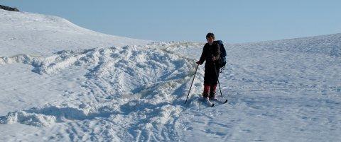 Reisadalen 16 mai 2010: Smeltevann pløyer opp snøen. Senere på dagen gikk det flere sørpeskred i dalsidene. Foto: Ola Solvang