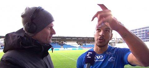 IKKE FORNØYD: Ohi Omoijuanfo sammen med Eurosport-reporter Pål Gordon Nilsen.