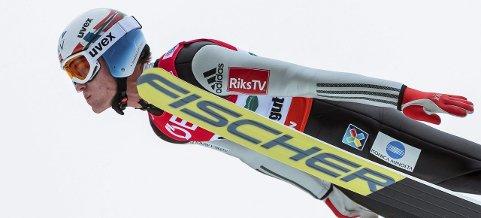 18. PLASS: Daniel-André Tande endte på 18. plass i VM i skiflyging.  Søndag kan han og det norske laget ta VM-gull. (FOTO: EPA/EPA/JFK)