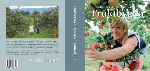 OMSLAGET: En epleplukkende Ingeborg Lindheim preger omslaget på boka Fruktbygda som kom ut to uker før jul.