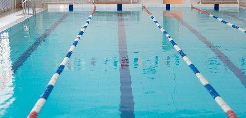 Empty new school swimming pool direct view