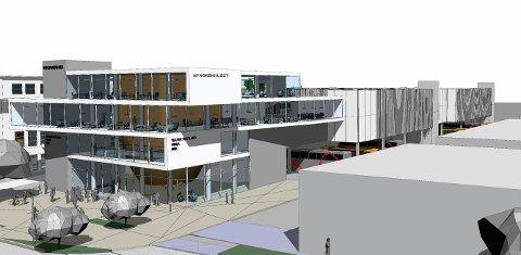 PARKERING: Bak kontorbygget er det planlagt nye parkeringshus som skal stå på søyler over bussparkeringa til Firda Billag.