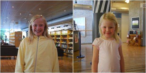 FORNØYDE: Ingrid Almklov (10) og Ida Marie (6) er glade for å kunne benytte seg av biblioteket igjen.