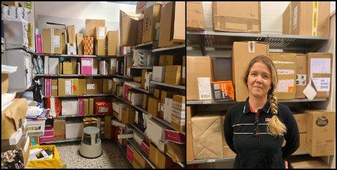 Slik ser det ut på det eine av tre lagerrom Spar Mongstad brukar til postpakkane. Til høgre kan ein sjå dagleg leiar i butikken Camilla Bogetveit.