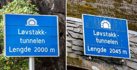 Løvstakktunnelen er 50 år i år. Skiltene som angir tunnelens lengde er derimot ulike.