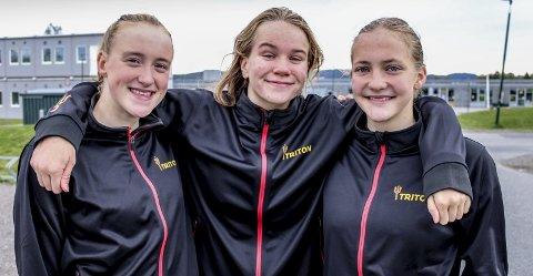 Vil holde sammen: Gwen Bergum (f.v.), Mari Moen og Frida Stretre Løbersli har allerede markert seg i svømmemiljøet. Nå håper Triton-trioen at de svømmer seg til landslagsplass. Foto: Martin Holterhuset