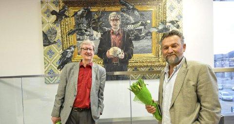 Hedersplass: Maleriet «Mentorens rite» måler 2x3,5 meter og har fått en hedersplass i Notodden bibliotek. Det skal fortelle alle besøkende at Notodden er stolt over både sin store forfatter Hans Herbjørnsrud og maler Tor Arne Moen.