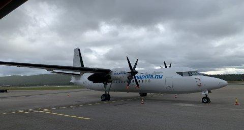 Amapolas Fokker 50, på Røros-besøk