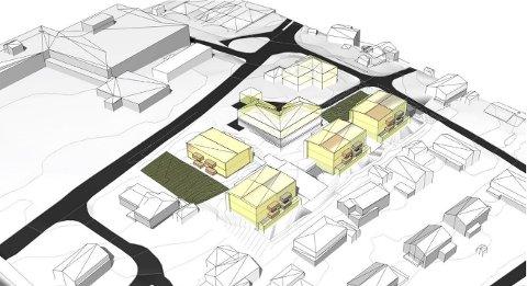 SLIK KAN DET BLI: Slik ser utbyggerne og arkitektene deres for seg at de fire planlagte flermannsboligene blir liggende i Bergliveien på Rolvsøy. Haugeåsen ungdomsskole i bakgrunnen øverst til venstre.