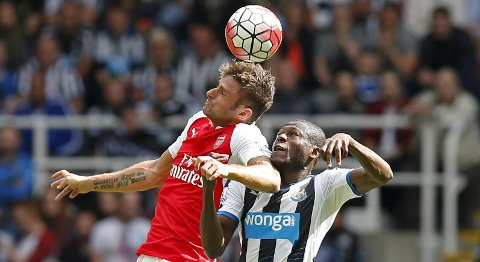 """Football - Newcastle United v Arsenal - Barclays Premier League - St James' Park - 29/8/15 Arsenal's Olivier Giroud in action with Newcastle's Georginio Wijnaldum Reuters / Andrew Yates Livepic EDITORIAL USE ONLY. No use with unauthorized audio, video, data, fixture lists, club/league logos or """"live"""" services. Online in-match use limited to 45 images, no video emulation. No use in betting, games or single club/league/player publications.  Please contact your account representative for further details."""