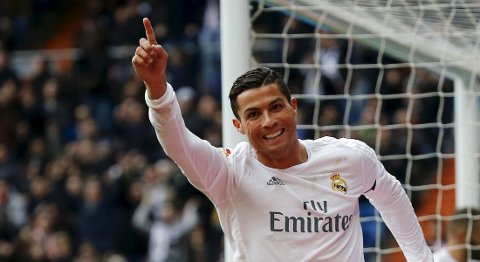 Football Soccer - Real Madrid v Sporting Gijon - Spanish Liga BBVA - Santiago Bernabeu, Madrid, Spain - 17/01/16  Real Madrid's Cristiano Ronaldo celebrates his second goal against Sporting Gijon. REUTERS/Andrea Comas