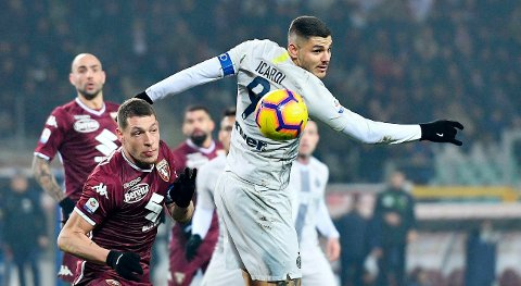 Torino's Andrea Belotti and Inter's Mauro Icardi, right, vie for the ball during the Italian Serie A soccer match between Torino and Inter Milan at the Olympic stadium in Turin, Italy, Sunday, Jan. 27,  2019. (Alessandro DI Marco/ANSA via AP)