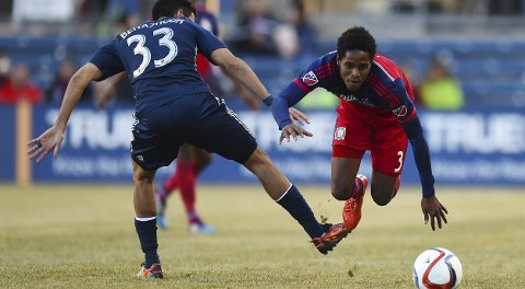 Mar 14, 2015; Chicago, IL, USA; Chicago Fire defender Joevin Jones (3) and Vancouver Whitecaps defender Steven Beitashour (33) attempt to get a loose ball during the second half at Toyota Park. The Vancouver Whitecaps defeat the Chicago Fire 1-0. Mandatory Credit: Mike DiNovo-USA TODAY Sports
