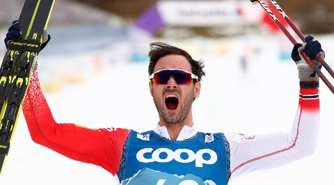 First place, Norway's Hans Christer Holund reacts during the WSC Men's Interval 15km Free Cross Country event at the FIS Nordic World Ski Championships in Oberstdorf, Germany, Wednesday, March 3, 2021. (AP Photo/Matthias Schrader)