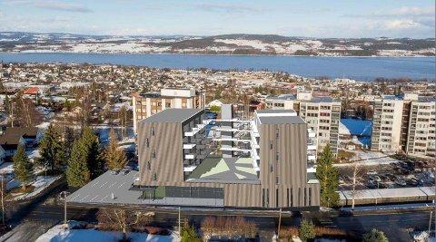 UVISST: Et slikt bygg er skissert for den nåværende parkeringsplass på Kopperud senter. Det er fortsatt uvisst om prosjektet blir realisert.  Illustrasjon: Anderssen og Fremming AS