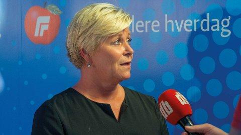 Jeg har fått fullmakt til å inngå avtalen med H, KrF og V, sier Siv Jensen.