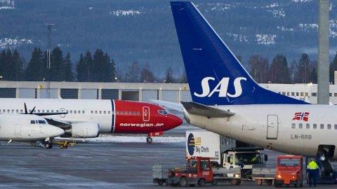 SAS har tettet et hull som har gjort det mulig å kjøpe flybilletter til spesielt lave priser. Norwegian opplyser at også de vil følge etter og tette det samme smutthullet. Foto: Ntb Scanpix