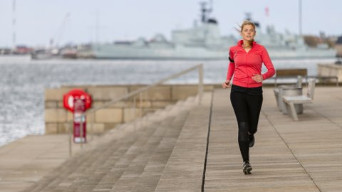 Sporty woman running and training in the city