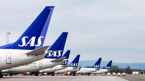 64.000 passasjerer rammes søndag når 587 nye SAS-avganger innstilles i Skandinavia søndag.