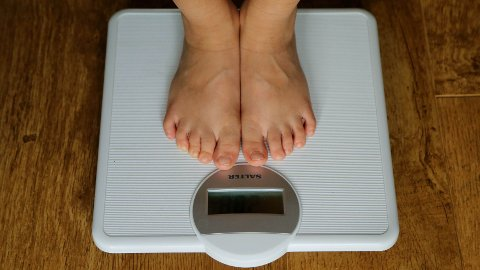 File photo dated 15/07/14 of a child being weighed on scales. Diabetes UK has said the rising tide of obesity has led to thousands of youngsters having Type 2 diabetes.
