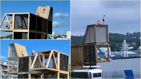 HOPPER FRA TAKET: Det er mange som velger å klatre opp på taket for bedre høyde.