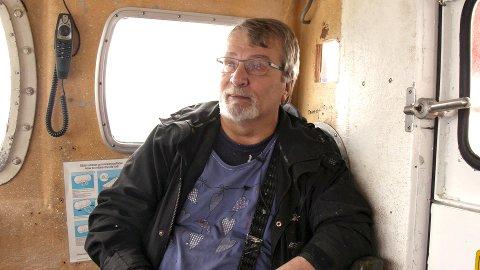 REDDET: Fylkesordfører Knut Werner Hansen falt i sjøen da han skulle forlate Vorterøya i oktober 2011. Der ble han liggende i en drøy halvtime i hardt vær, før hjelpere fikk dratt ham opp.