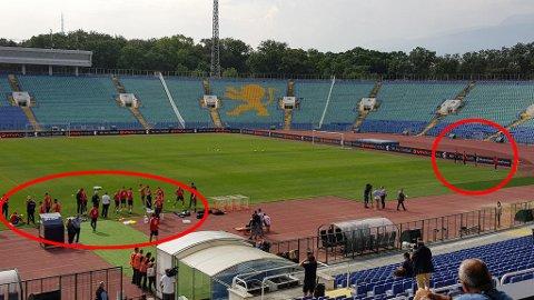 KAMP MOT KLOKKA: Her står de norske landslagsspillerne før trening på nasjonalarenaen i Sofia før møtet med Bulgaria. Så fort en spiller går inn på banen begynner landslagets tilmålte time å telle ned. Derfor må alt av spillernes forberedelser gjøres utenfor banen. Foto: Nettavisen
