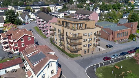 BYGGEPLANER: Dronebildet viser hvordan den fem etasjer høye hjørneblokka vil ta seg ut i forhold til omgivelsene i Nybyen.  (Illustrasjon: Viken Designstudio)