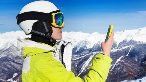 Det gjelder å passe godt på mobilen i alpinbakken.