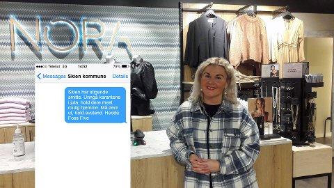 REAGERER: Anette Elseth Bergane hos motebutikken Nora reagerer på tekstmeldingen fra ordføreren. Foto: Helle Reiersen