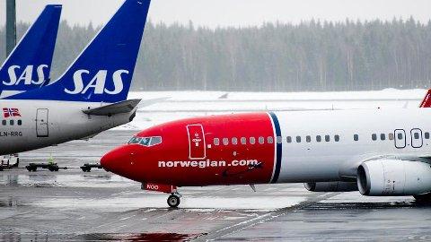 Reisende som ikke får brukt en bestilt lavprisbillett, kan være ekstra god butikk for SAS og Norwegian. Foto: Jon Olav Nesvold, NTB scanpix/ANB