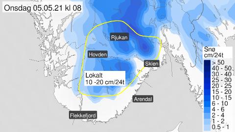 Områdene innenfor den gule linjen kan fort få en del snø tirsdag og onsdag.