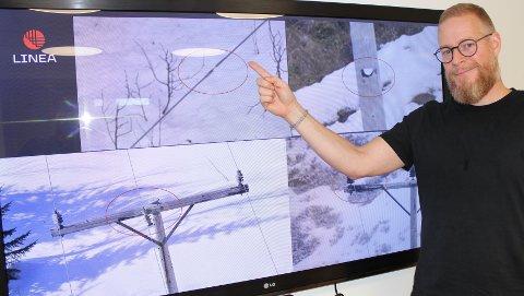Prosjektleder Eskil Strøm i Linea viser skader funnet ved helkopterbefaring tidligere.