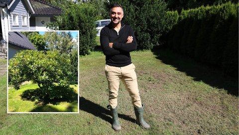 FRIGJORDE PLASS: Mano Rashidi (42) ga bort rhododendron-busken i hagen for å frigjøre plassen foran huset. – Her blir det trampoline og kanskje et epletre etter hvert, sier han.