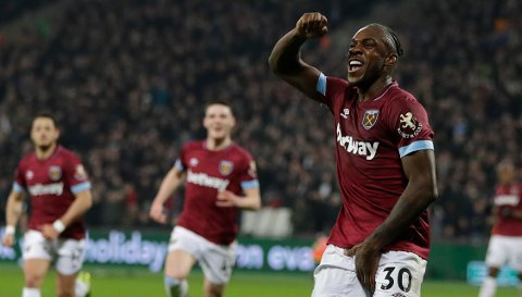 West Ham's Michail Antonio celebrates after scoring his side's first goal during the English Premier League soccer match between West Ham United and Liverpool at the London Stadium in London, Monday, Feb. 4, 2019.(AP Photo/Kirsty Wigglesworth)