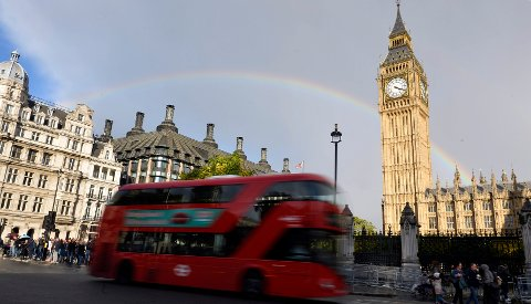 A rainbow is seen behind the Big Ben clock tower, at the Houses of Parliament in central London, Britain, October 16, 2016. REUTERS/Hannah McKay