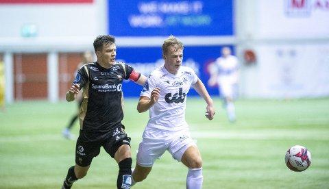 Aune Heggebø (til høyre) spilte mot Tromsø for en uke siden. Tromsø er higne på å skaffe seg Heggebø, men Brann har avslått første bud. Det er slettes ikke sikkert at Heggebø godtar en overgang heller, for han vil helst spille mot Tromsø, for Brann, i eliteserien neste år.