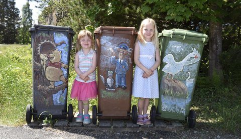 Elise Marie (4) og Hanne Sofie (7) og familien Skotheimsvik på Tyristrand har fått mange positive reaksjoner på sine fine søppeldunker. Men HRA vil ikke ha malte dunker.