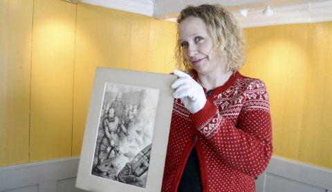 Spennende: Christine Hermansen med en av Theodor Kittelsens illustrasjoner til boka om Hellig Olaf.