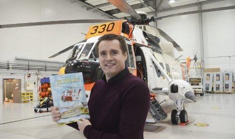 Fornøyd: Øyvind Grønbech, forfatter av og initiativtaker til «Flybyen», er strålende fornøyd etter lanseringen av barneboka forrige helg. Nå er så å si hele førsteopplaget utsolgt. Foto: Jørgen Mathisen/Avisa Nordland