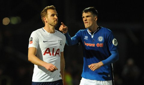Rochdale's Ryan Delaney points at Tottenham's Harry Kane during the English FA Cup fifth round soccer match between Rochdale AFC and Tottenham Hotspur at the Crown Oil Arena in Rochdale, England, Sunday, Feb. 18, 2018. (AP Photo/Rui Vieira)