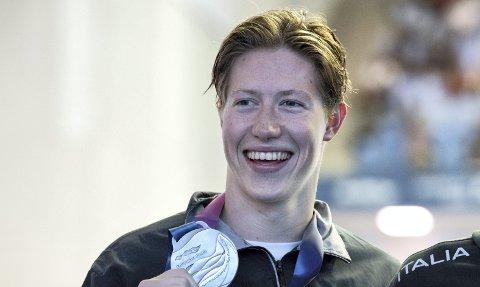 SØLVGUTTEN: Henrik Christiansen satte ny person rekord med tiden 7:41.28 og svømte inn til VM-sølv bak italienske Gregorio Paltrinieri på 800 meter fri i Gwangju i Sør-Korea onsdag. Franske David Aubry tok bronsemedaljen.