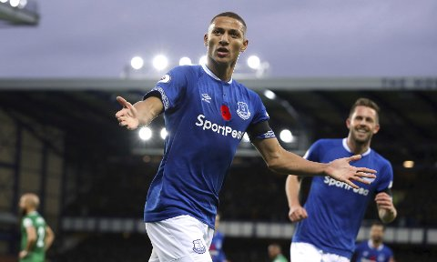 Everton's Richarlison celebrates scoring his side's first goal of the game during the English Premier League soccer match between Everton and Brighton and Hove Albion at Goodison Park stadium, Liverpool, England. Saturday Nov. 3 2018 (Martin Rickett/PA via AP)