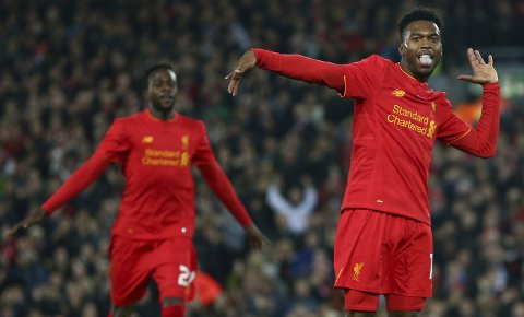 Liverpool's Daniel Sturridge, right, celebrates scoring the second goal of the game during the English League Cup soccer match between Liverpool and Tottenham Hotspur at Anfield in Liverpool, England, Tuesday, Oct. 25, 2016.(AP Photo/Dave Thompson)