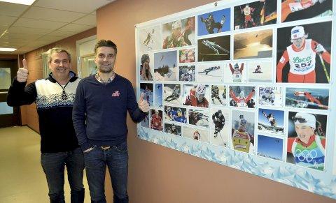 SJEFENE: Sportssjef Trond Hårberg og assisterende sportssjef Halvor Persson er sjefer for de gode tidene ved NTG Lillehammer. På veggen er det bilder av flere tidligere NTG-elever og OL-deltakere. Foto: Kjell H. Vollan