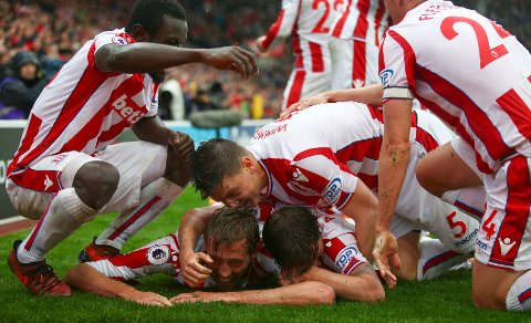 Stoke City's Peter Crouch, bottom, celebrates scoring the winning goal against Southampton during the English Premier League soccer match between Stoke City and Southampton at the bet365 Stadium, Stoke, England, Saturday, Sept. 30, 2017.  (Dave Thompson/PA via AP)
