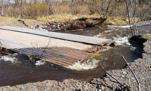 TANA: Vannstanden stiger i elver over hele fylket. Dette bildet er tatt for noen dager siden.