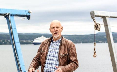 Talefør: Daglig leder i Norsk Yrkesdykkerskole AS, Dag Wroldsen, er blant dem som stiller spørsmål om framtidig utbygging på Fagerstrand. Foto: Staale Reier Guttormsen