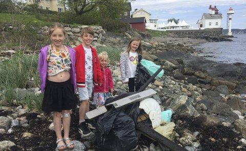 MILJØVERNERE: Disse fire miljøvernerne, Mia, Albert og Wilma Lind Hodgson og Hermine Grinnes, fant mer søppel enn de kunne bære på en tur. Foto: Privat