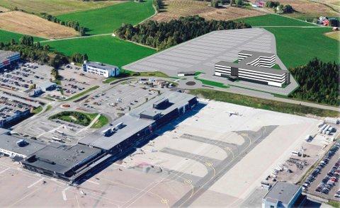 PLANER: En tidligere skisse for det planlagte hotell- og internatbygget og 1.500 parkeringsplasser på vestsiden av Torpveien. (Illustrasjon: Cosmic Bygg)
